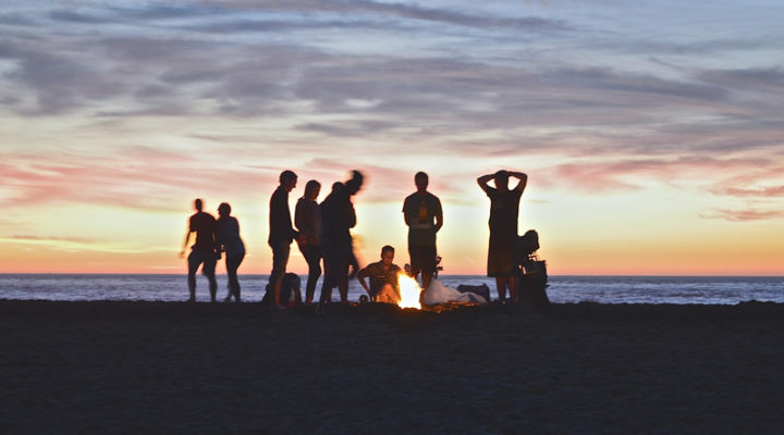 discipleship. how to disciple. make disciples. image of teens at a beach bonfire.