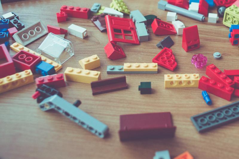LEGO building bricks scattered on floor